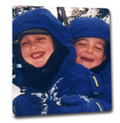 Two boys having fun in the snow